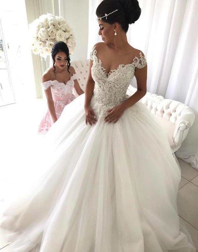 Moda Sparkly Contas De Cristal Princesa Nova Bola Vestido de Casamento Vestido de Manga Curta Custom Made Nupcial Do Laço de Tule de Alta Qualidade Transparente
