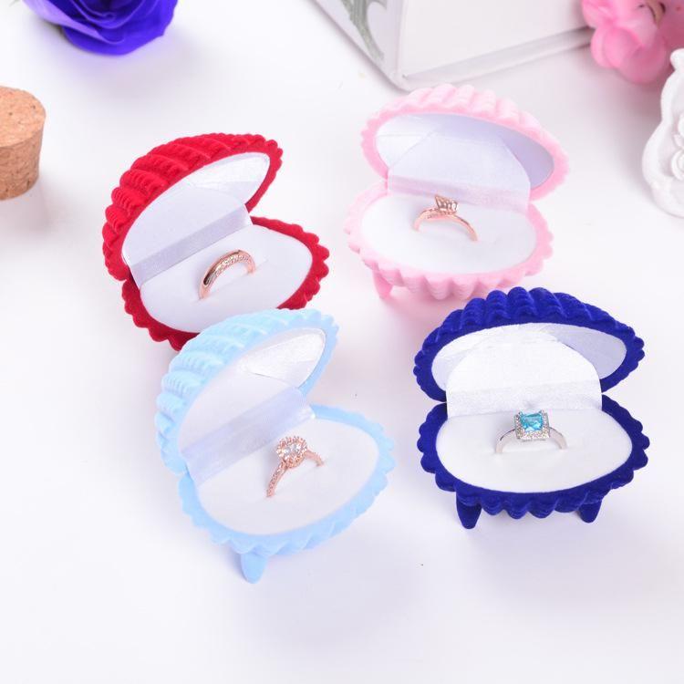 Caja de joyería de alta calidad flocado Caja de anillo de Shell Caja de joyería creativa cajas de anillo caja de terciopelo Pendiente Joyería Caso venta directa