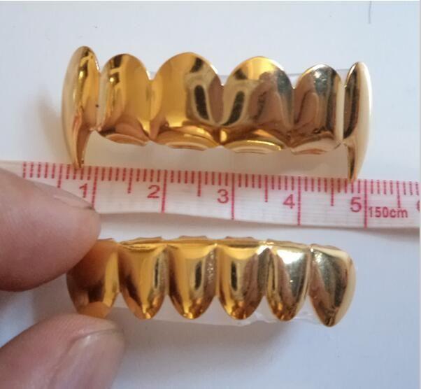 Großhandel-echtes Gold echt glänzend !! IMI Silber überzogener Hiphop Tush-Zähne Vampir Grillz-Oberteil und unterer Grillset