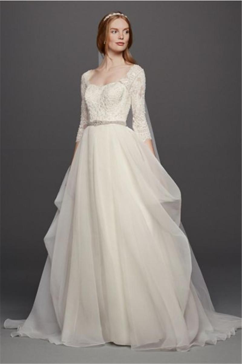 Organza 34 sleeved wedding dress cwg731 lace sleeves and a organza 34 sleeved wedding dress cwg731 lace sleeves and a flattering sweetheart neckline beading junglespirit