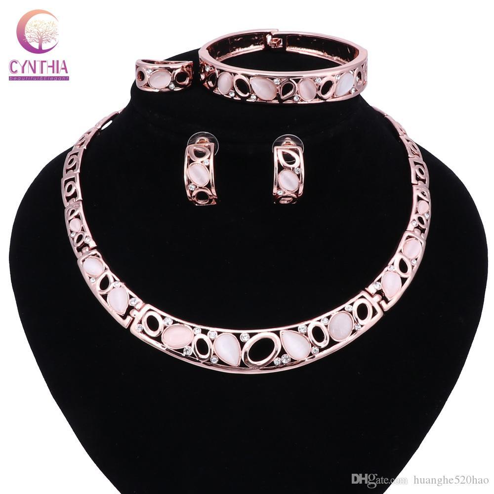 Set di gioielli Fashion Party Set Cat Pink Eye opale con strass goccia orecchini delle collane Bangle Ring per donne / ragazze