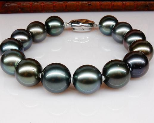 Atemberaubende 10-11mm Tahitian Runde Pfau grüne Perle Baracelet 7,5-8 Zoll