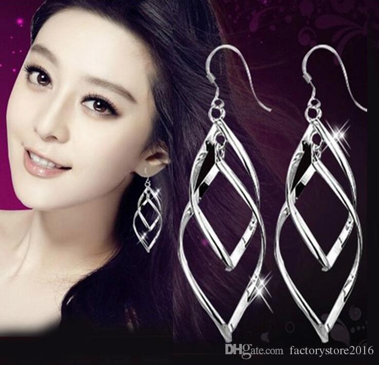 Gli orecchini d'argento 925 stupefacenti per i monili degli orecchini di fascino di Ciondolo di goccia di modo S925 delle donne liberano il trasporto