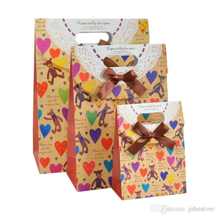 custom full color printed birthday gift bag with bowknot fashion die-cut handle design goodie bag wedding gift paper bag