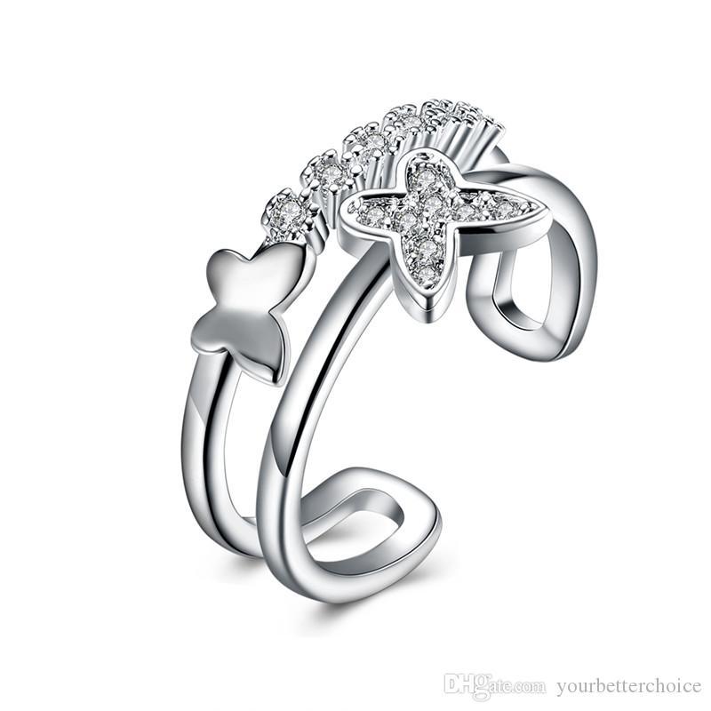 Extravagantes stilvolles Frauen-Silber überzogene justierbare Manschette-Schmetterlings-Muster-offene hohle Klumpen-Kroneneinstellung CZ-Ring geben Verschiffen frei