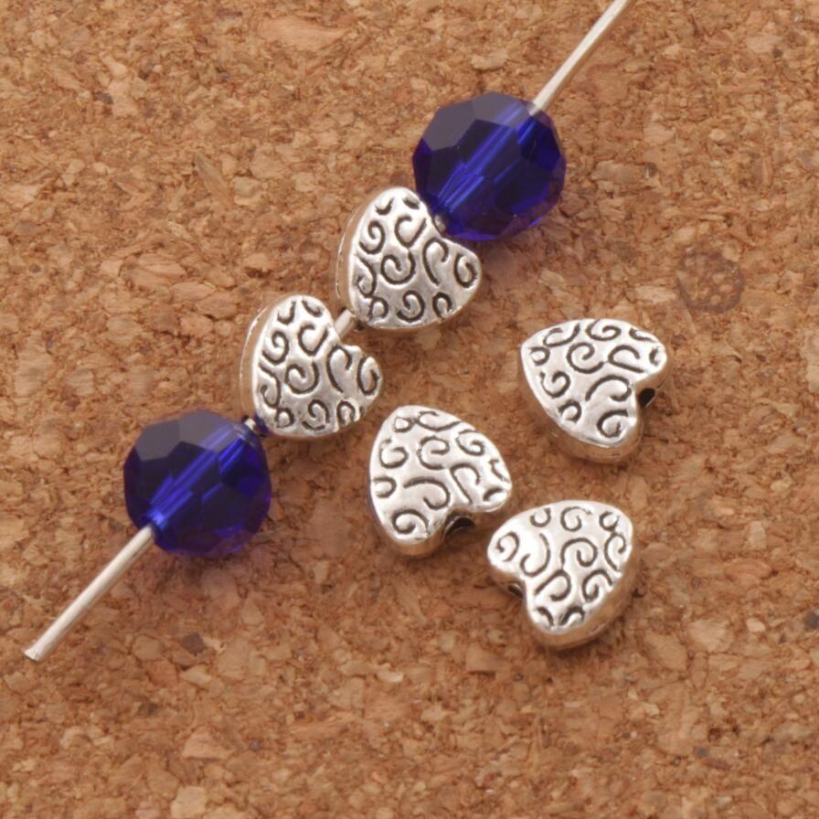 Fantaisie Artisanal Coeur Entretoises Perles 500pcs / lot 5.9X6.1mm Bijoux En Argent Tibétain Perles Lâches DIY L1767