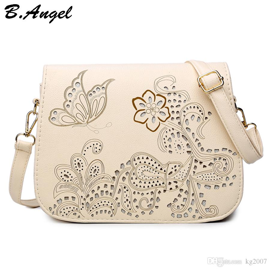 High quality flowers and butterfly Hollow Out messenger bag for women purse cross body school bag Saddle PU Leather Bag