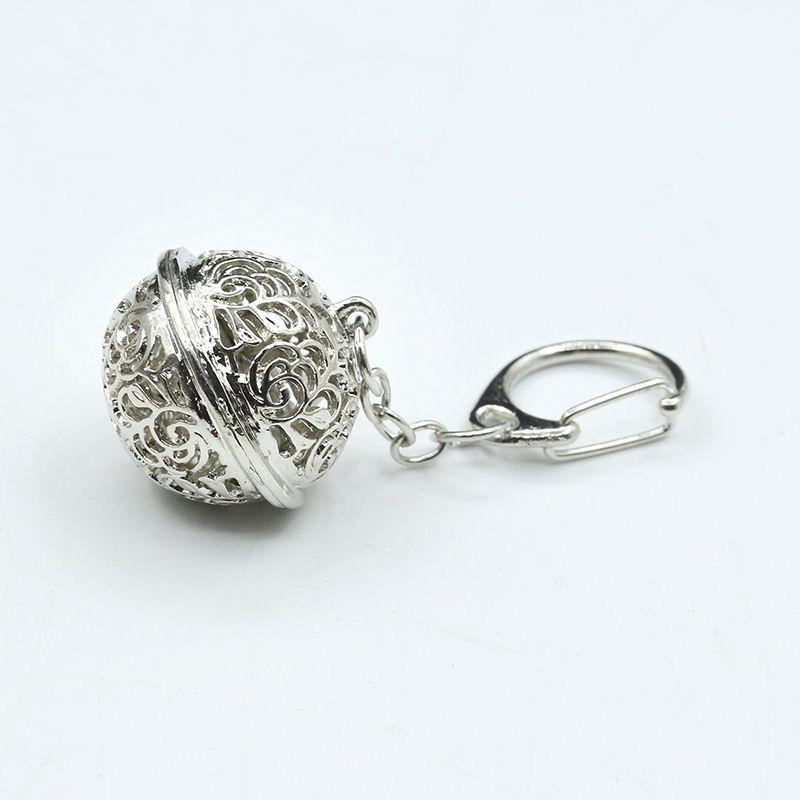 Color de plata preciosa campanas llaveros aleación de protección del medio ambiente aleación de juguete hueco llavero para mujeres regalo chica monedero colgante