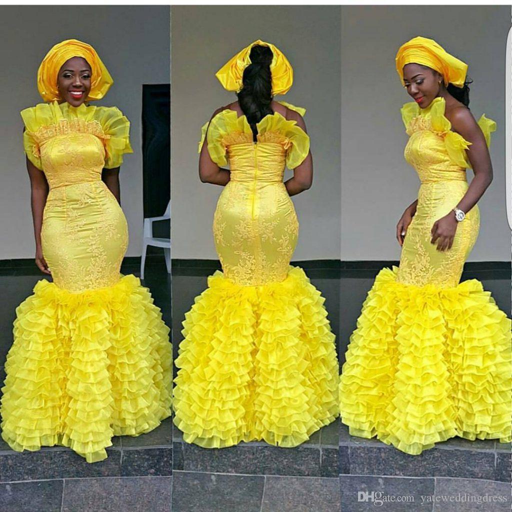 Aso Ebi Abito da sera giallo Plus Size Prom Abito da sposa con pieghe Pieghe su misura Applique Scollo speciale Design speciale Abiti da cerimonia