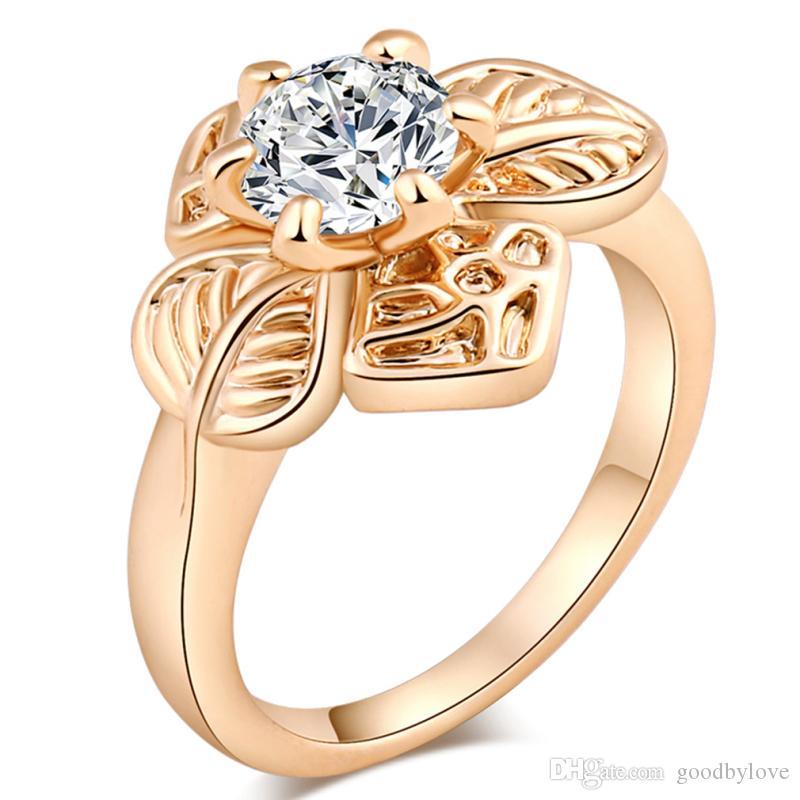18 quilates de oro amarillo plateado cuatro pétalos de las flores Gran Cubic Zirconia dedo anillo de CZ para la joyería partido de las mujeres de moda las niñas Bijoux regalo caliente
