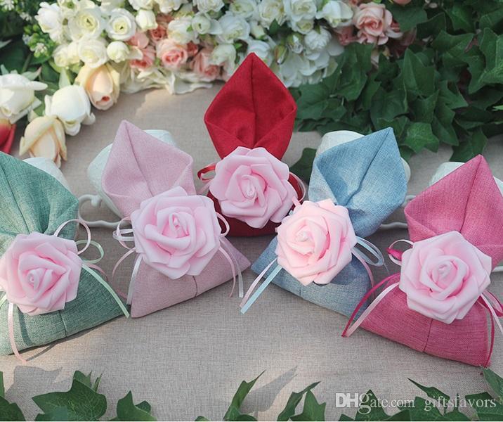 Льняные сумки 100 шт. Предохранить Ткань Бесплатная роза Держатели Лот Лот Candy Шоколад Гости для цветка Свадебная доставка Оптовая продажа Saxtr