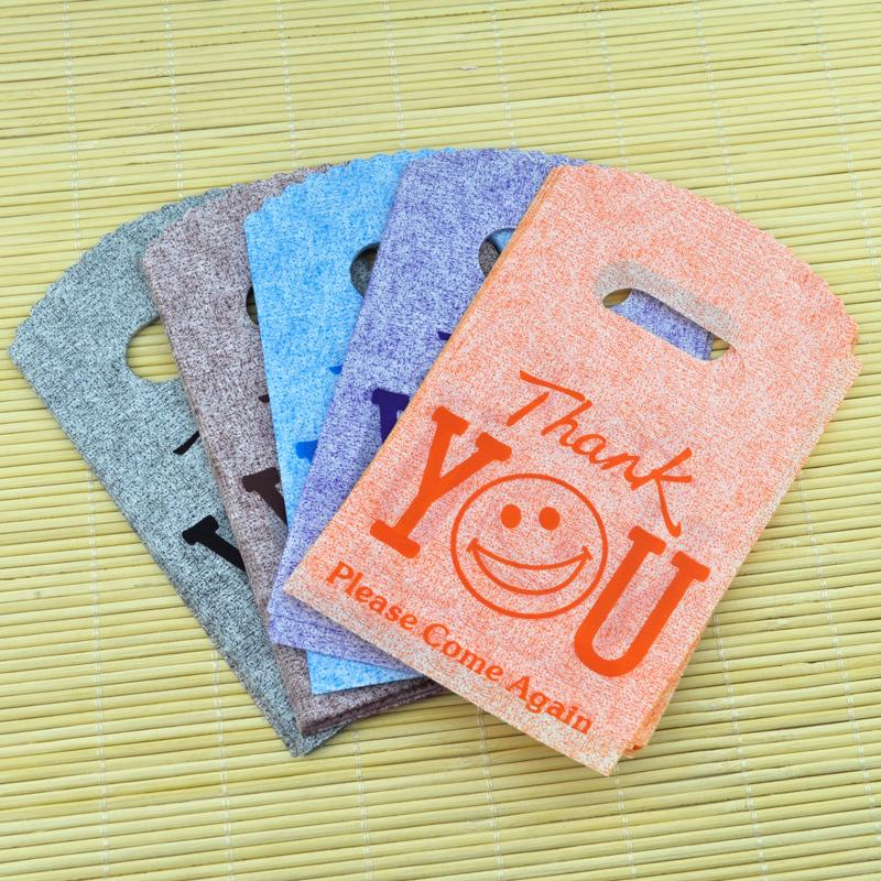 Wholesale-100pcs 9x15cm small plastic gift bags smile thank you color random color plastic Pouches for jewelry Boutique gift