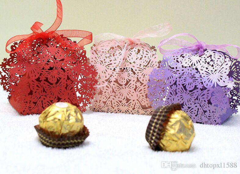 Nouvelle boîte de bonbons de boite de bonbons de papillon creux de style européen de style européen Boîtes de chocolats avec ruban pour la fête de mariage Baby Douche Donne-cadeau