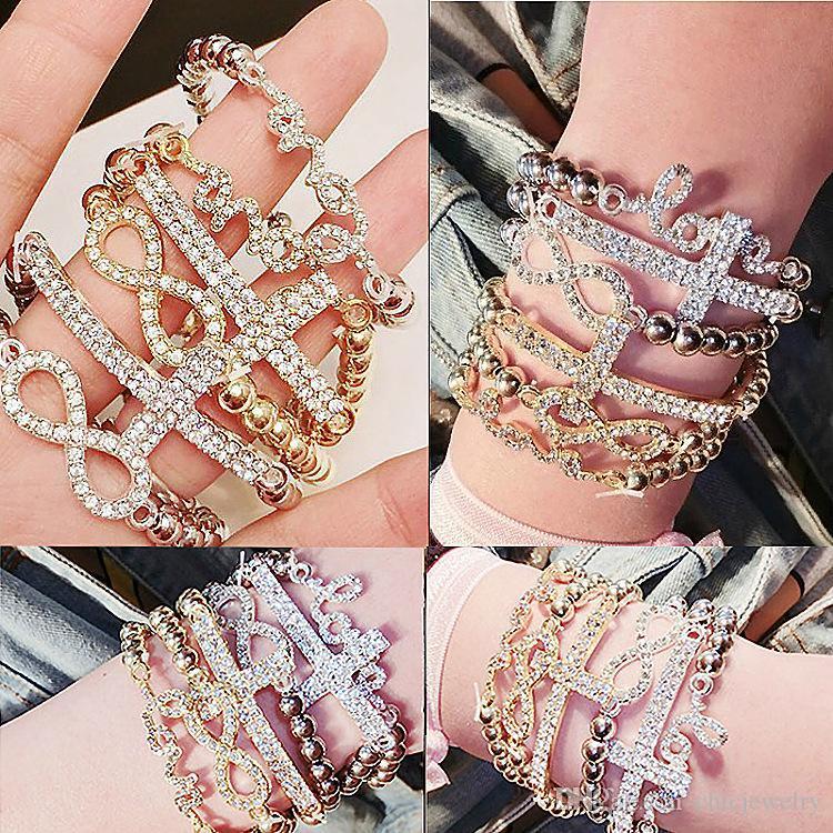 Klassisches Liebes-Kreuz-Unendlichkeits-Charme-Armband-Frauen-Art- und Weiseschmucksache-Goldsilberrhinestone-Kristall Bördelnder Armband-Schmuck-Elastizität 6 Arten