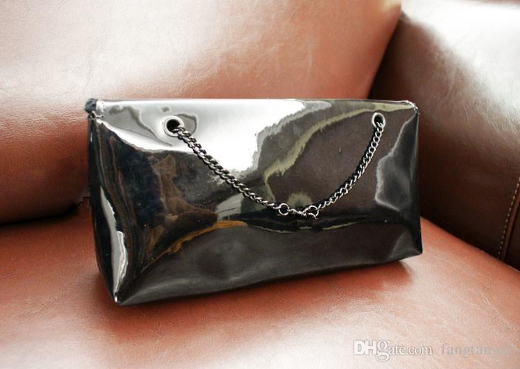Klassische Muster schwarz / weiß PU Farbanstrich Tasche Frauenhandtasche mit dem berühmten Logo Kosmetik Make-up-Paket