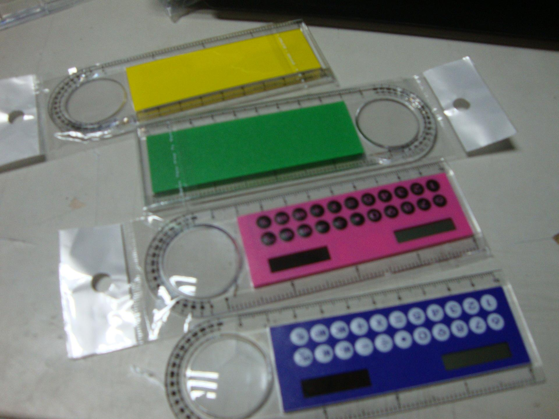 Calculatrice personnalisée professionnelle directe du fabricant Mini 10CM calculatrice en plastique règle loupe