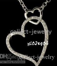 18k vit guldkristall dubbel hjärta halsband