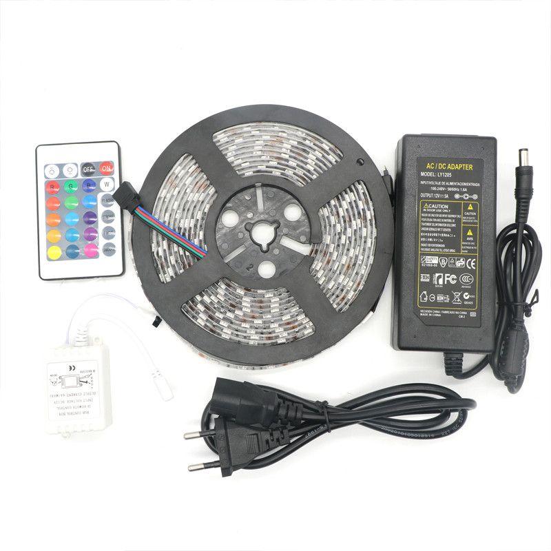 La tira llevada RGB 5M SMD 5050 60LED / Meter flexible impermeable IP65 conector remoto IR 24key llevó el regulador 5A Fuente de alimentación UE BRITÁNICA para la Navidad