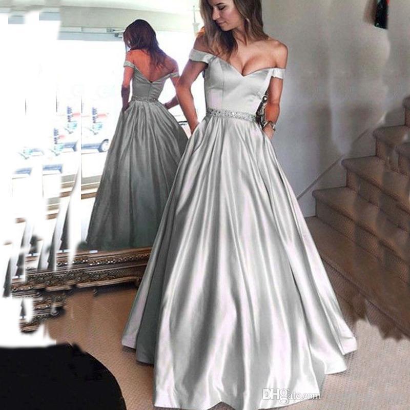 Atemberaubende bescheidene Prom Kleider aus der Schulter Abendkleid Silber A Line Guest Dress mit Perlen Taille und Fashin Taschen nach Maß