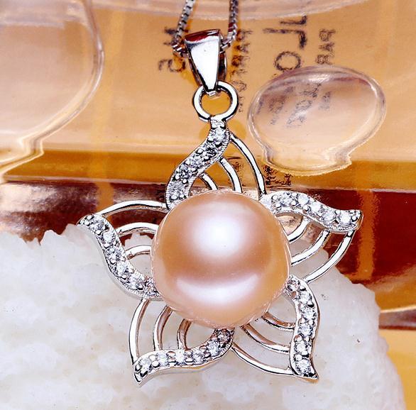 Heiße Verkaufsfrau 11-12mm oblate hängende Halskette der natürlichen Perle 925 silbernes DZ0209