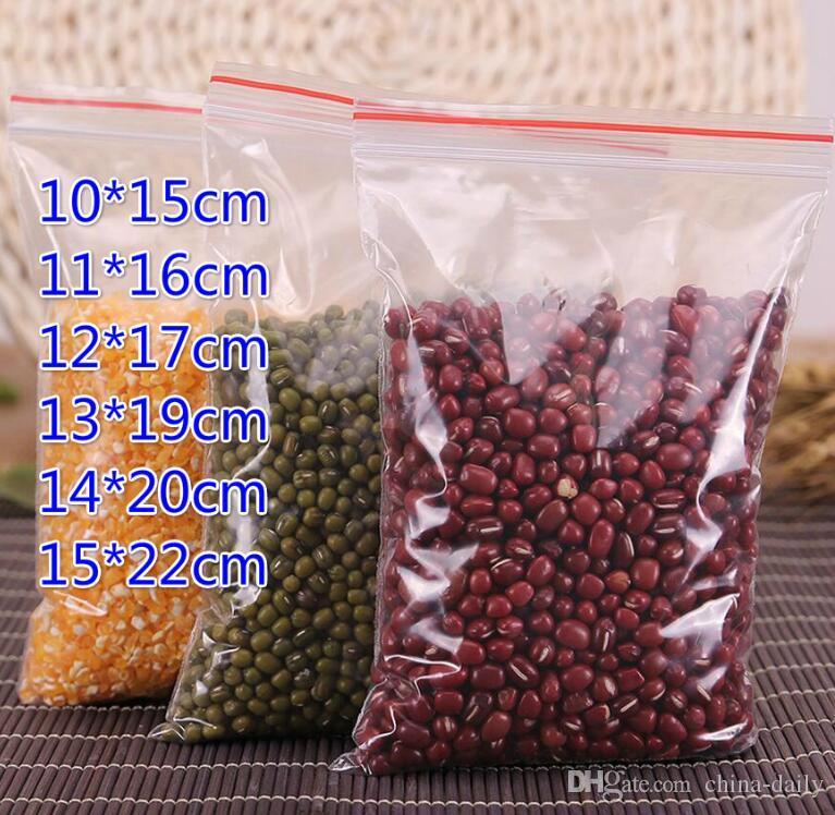 100 pcs / lot (10 * 15 cm 11 * 16 cm 12 * 17 cm 13 * 19 cm 14 * 20 cm 15 * 22 cm) en plastique refermable transparent sacs PE Zip Lock stockage des aliments bijoux bagues sacs