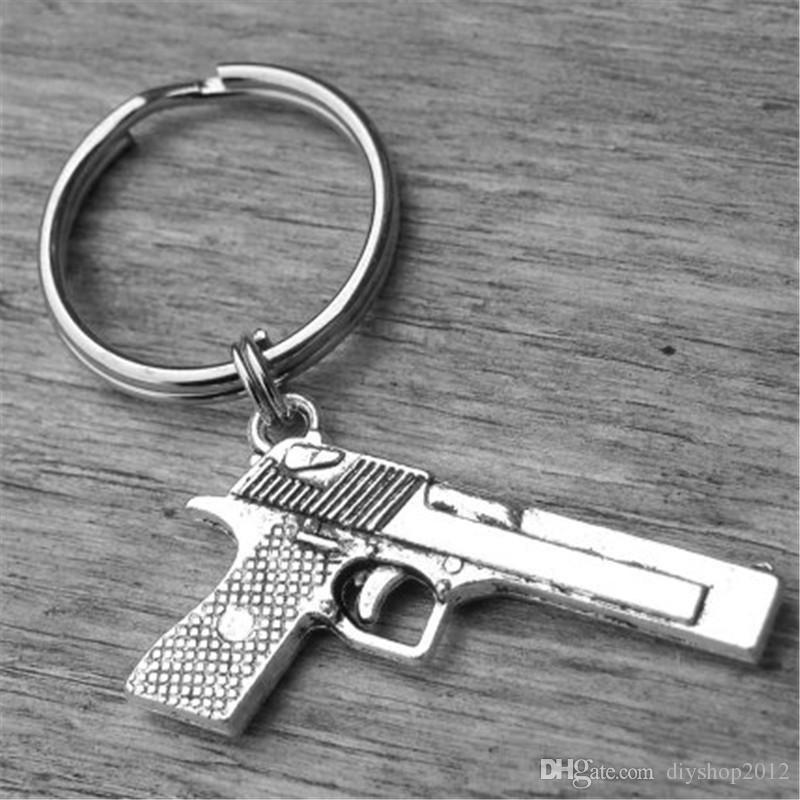 12pcs pistola llavero arma llavero arma de plata accesorio revólver pistola escopeta pistola vaquera