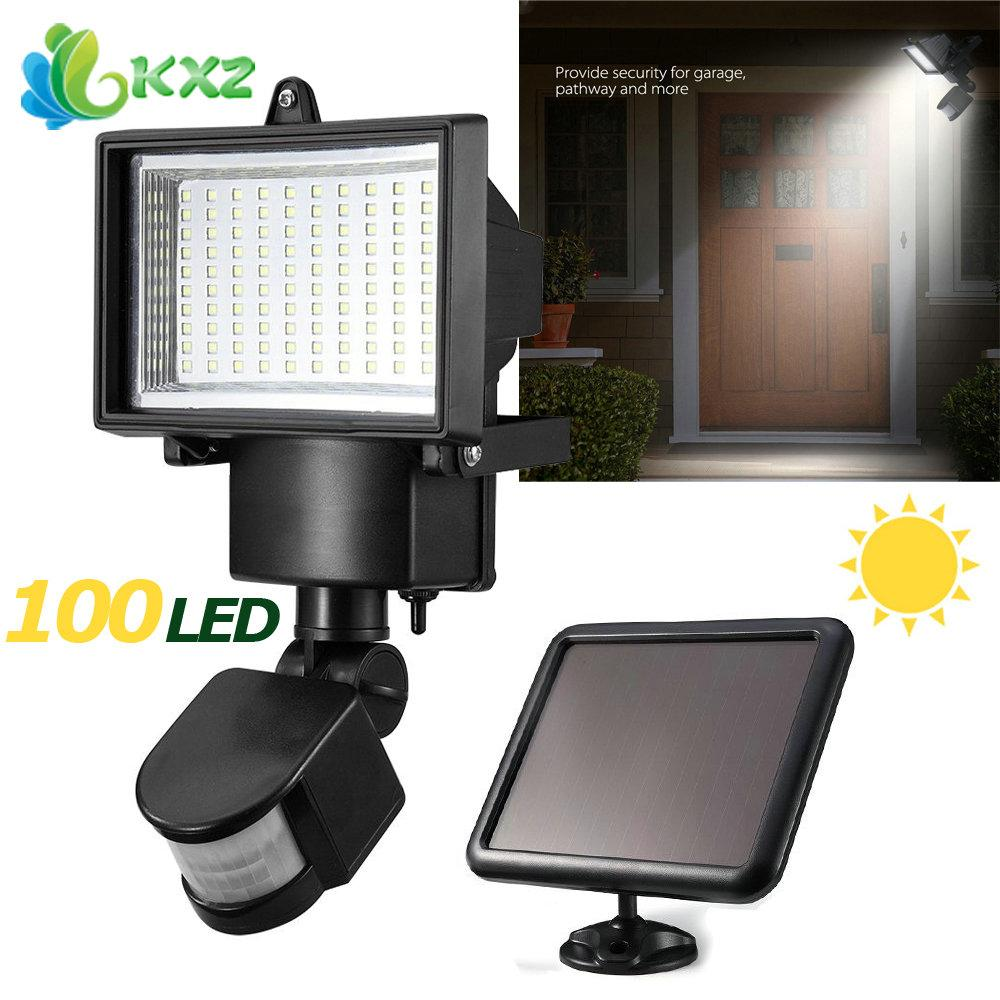 Wholesale-Solar Power Panel 100 SMD LED Flood Light Motion Sensor Outdoor Garden Yard Street Path Landscape Seucrity Lamp Floodlight