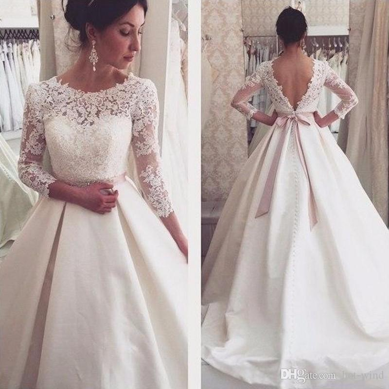 Discount Vintage Sheer Long Sleeve Wedding Dresses 2020 Jewel Neck Lace Top Sexy Backless Satin A Line Bridal Gowns With Crystal Sash Arabic Wedding