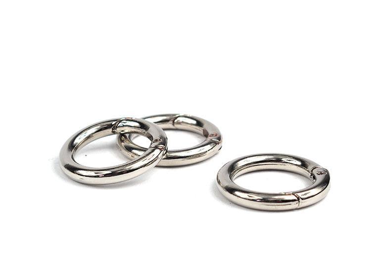 Muelle anillo obturador con 2 ojales 25 mm de metal plata 1x #01.00089