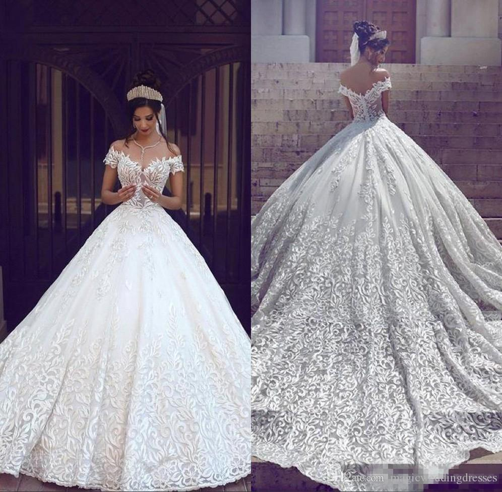 Saudi Arabic Dubai 2019 Luxury Short Sleeves Wedding Dresses Off Shoulder Appliques Backless with Sweep Train Bridal Gowns Robe de marriage