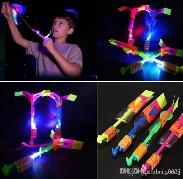 200pcs Flashing helicopter stunning LED light arrow rocket helicopter rotating flying toy side fun gift red and blue double flash