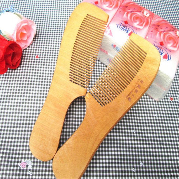 Saf doğal şeftali ahşap tarak bakım kozmetik anti-statik tarak 2 yuan toptan süpermarket tezgahları