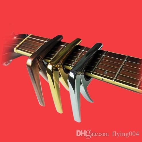 L'ammortizzatore del silicone della lega di alluminio del capo della chitarra elettrica di AROMA protegge le corde capo della chitarra popolare Alta qualità di trasporto libero