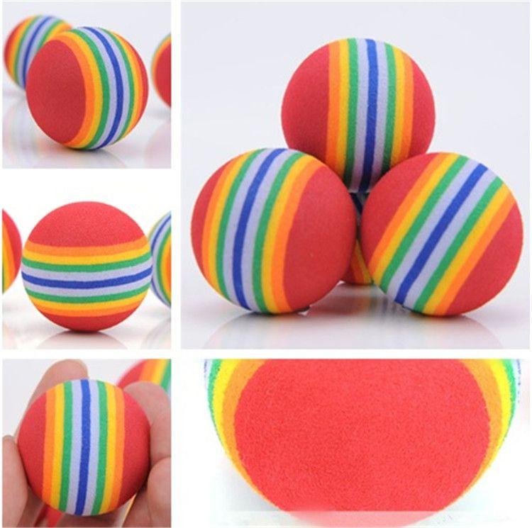 35 mm de diámetro interesante perro Juguete para mascotas y juguetes gato súper juguete de dibujos animados lindo del arco iris de la bola de peluche de juguete IA602
