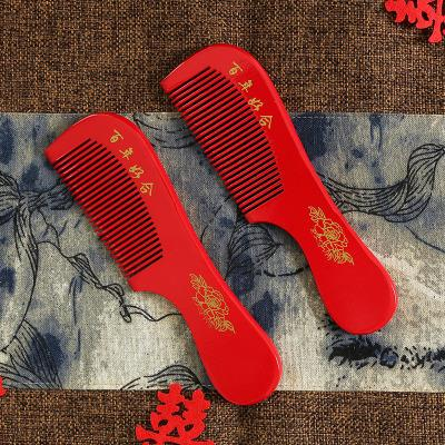 웨딩은 도매 제조 업체 애호가 빗의 Yuanyang 모델을 지참하기 위해 빨간색 단어 플라스틱 빗을 제공합니다