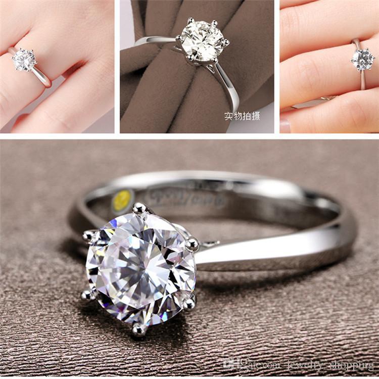 Neue Luxus-Modeschmuck nachgemachte überzogene Rhodium 6 Klaue Simulation Diamant Ehering Größe 4 Österreich Tschechische Zircon Ring