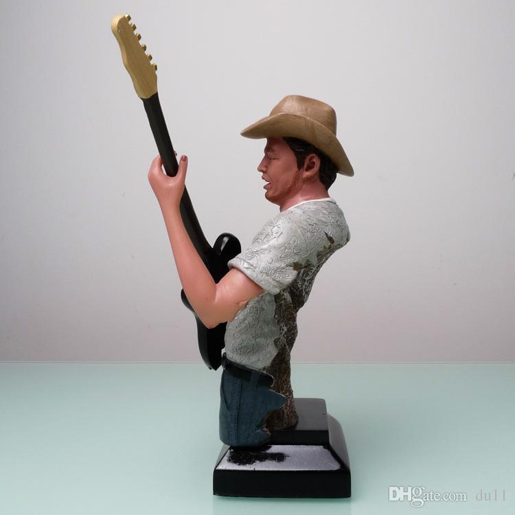 43 * 33 * 20CM Western Un cow-boy guitariste figure musicale musique sculpture artisanat import ventes showroom décoration envoyer à des amis de coupe