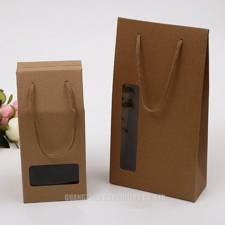 Bolsas de papel Kraft con corte de ventana de pvc Bolsas de embalaje con asas de alta calidad Precio barato Bolsas de papel personalizadas para regalo de promoción