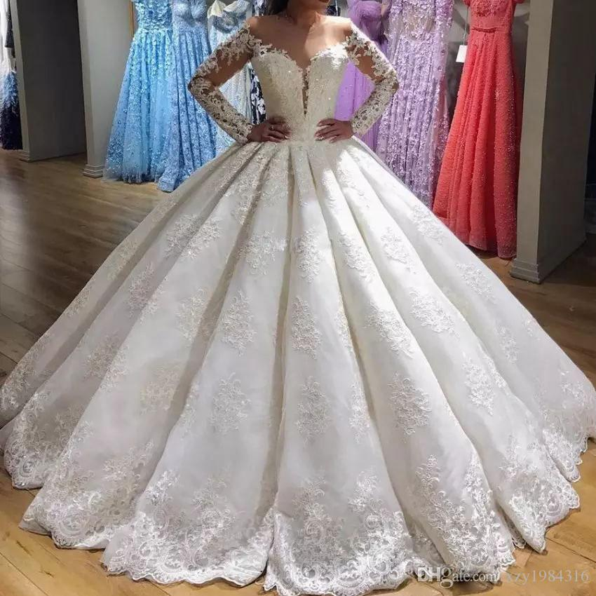 Voir à travers Jewel-Neck Robes de mariée Applique dentelle à manches longues Ligne-Robe de mariée Nouvelle arrivée dentelle robe de bal Robes de mariée