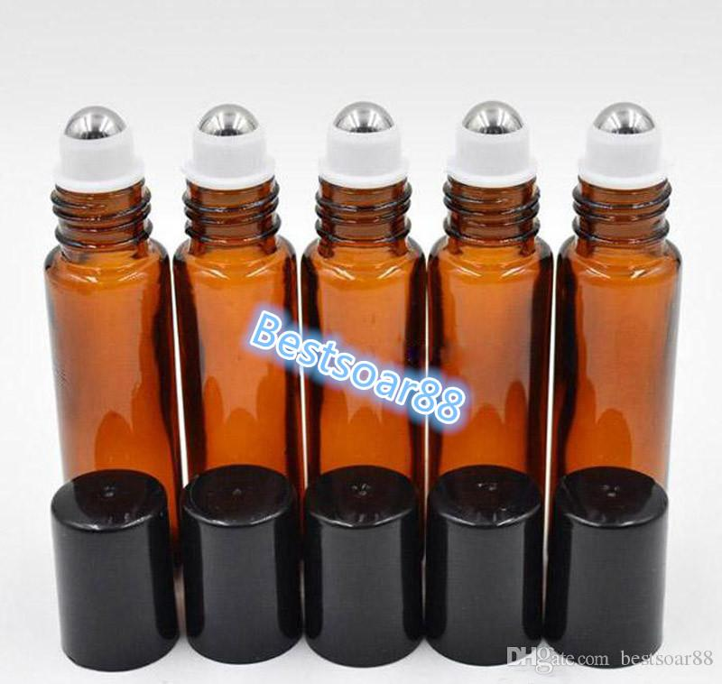 Venta al por mayor de 1/3 oz botellas de aceite esencial de vidrio ámbar 10 ml rollo en frascos con casquillos de bola de acero inoxidable negro para perfume de aromaterapia