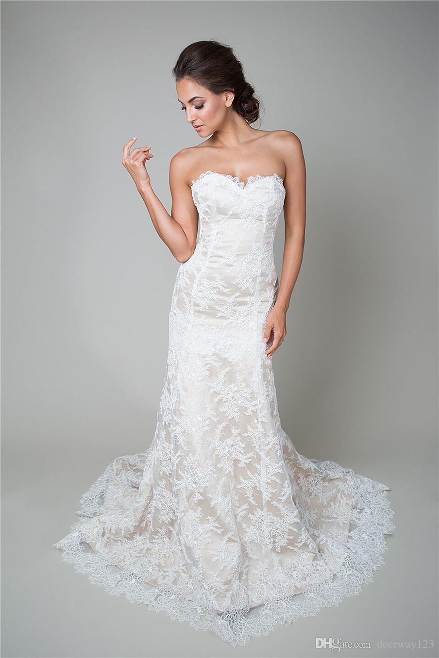 trumpet style wedding gown champagne base with corded lace a pinched  sweetheart neckline low back covered buttons bridal dress knee length  wedding