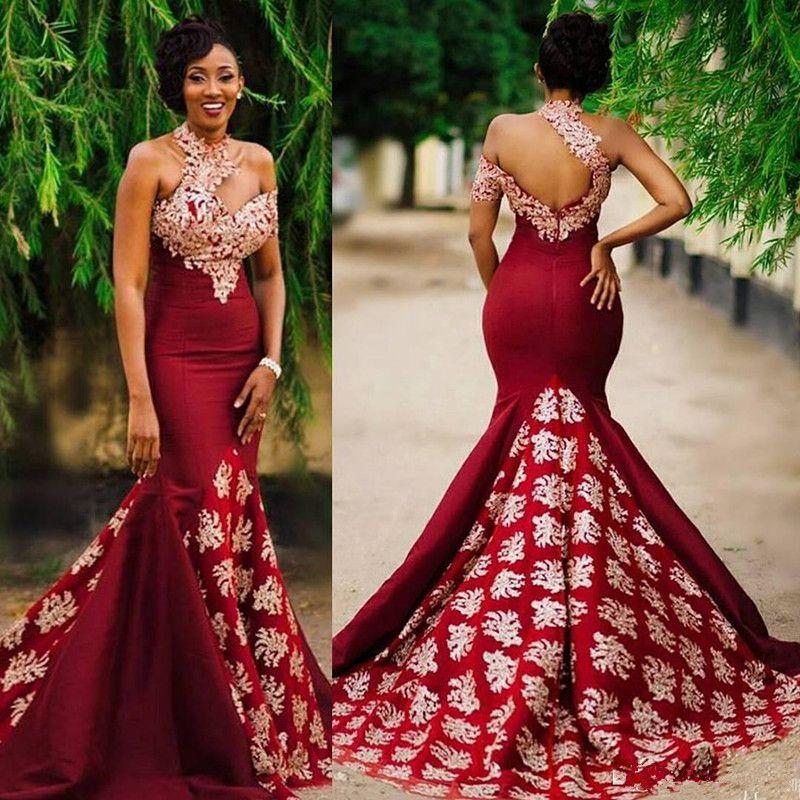 Aso Ebi Estilo Vestido de noche de sirena sexy rojo oscuro Vestidos modestos Encaje Cuello alto Sin respaldo Barrido Trumpet África Vestidos de fiesta de baile
