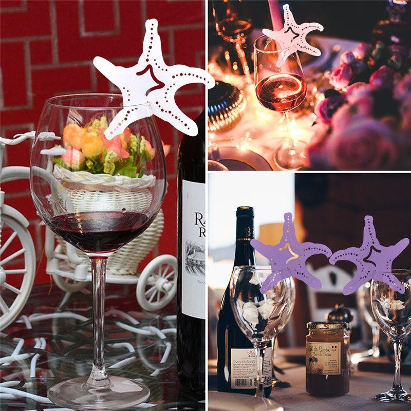 50 unids / lote envío gratis Laser Cut Paper Wedding Party Table Nombre Place Cup Cards estrellas de mar huecos Diseño Favores de la boda Fuentes Del Partido