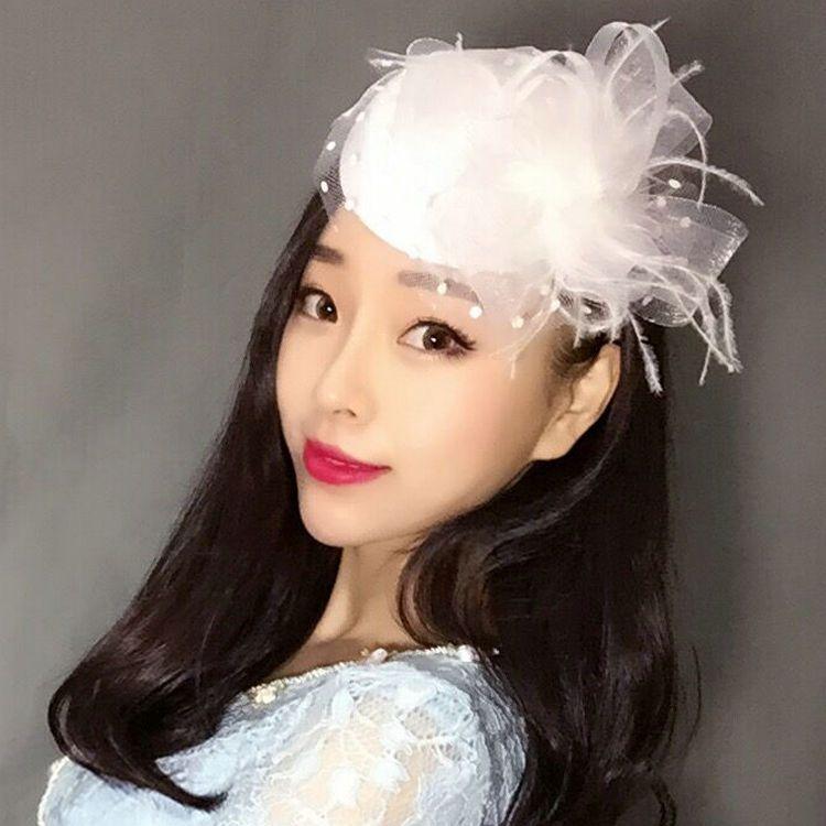 Coiffure femme coiffure de mariée rétro plume Voir les cheveux de grand arc Princesse petit chapeau coiffure partie.