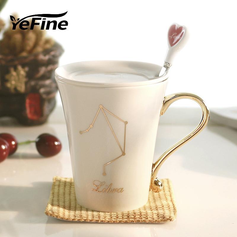 Venta al por mayor - YeFine 12 Constelación Tazas de café Porcelana ósea Chapado en oro Regalos del día de San Valentín Amantes Cápsulas de cerámica con tapa y cuchara