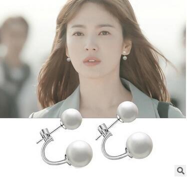 Mare di una conchiglia che indossa due versioni coreane del vento invernale che soffia nello stesso paragrafo orecchini in argento 925 con perle
