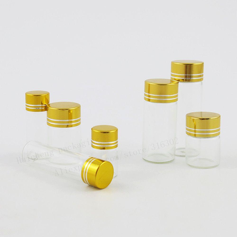 50 X 2ML 5ML 6ML 4ML 10ML 15 ML Mini botella de aceite esencial de vidrio transparente Oro tapa de aluminio Muestras Envases de vidrio