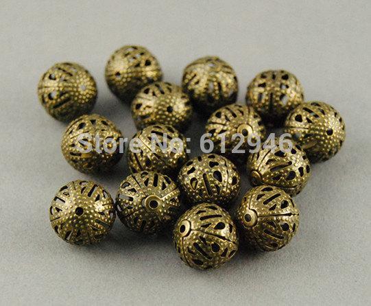 Kostenloser Versand! 100 Stück antike Bronze filigrane Perlen Spacer Hohlperlen 12mm Metall Armband Halskette Schmuckzubehör