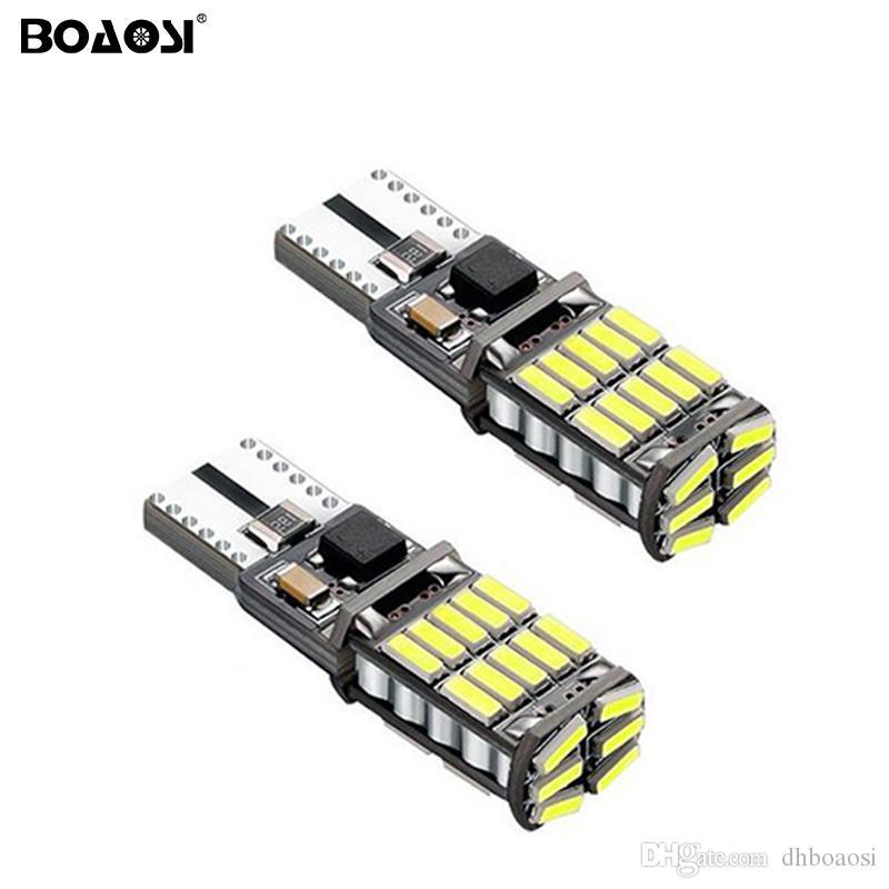 Source lumineuse superbe menée blanche lumineuse de source de la voiture 4014 W5W T10 LED l'ampoule 12V de lampe de lumières avec la lentille de projecteur