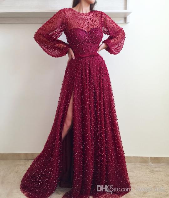 Robes de bal de luxe Dubaï en dentelle perlée Puffy à manches longues côté perles de Split Bow Sash Plus Taille élégante robe de soirée formelle 2020